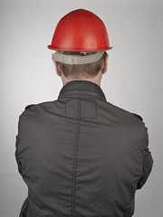 Back of worker man on grey background