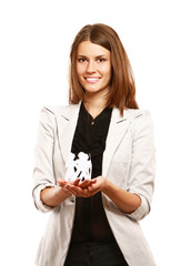 A businesswoman holding paper people
