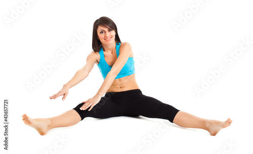 Woman doing fitness isolated on white