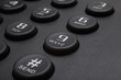 Buttons of black phone closeup
