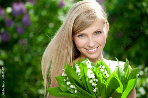 Portrait of young beautiful smiling woman outdoors