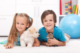 Happy kids with their pets - a dog and a kitten