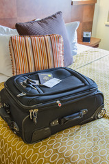 Roll Aboard Bag on a Hotel Bed