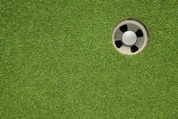 golf hole on a field