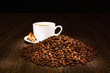 Coffee beans and white cup