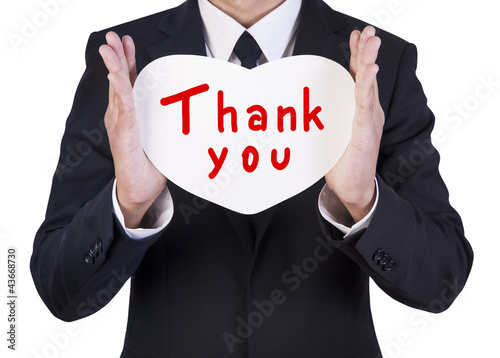 Businessman holding paper heart shape