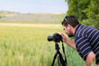 Photographer with  tripod and DSLR camera