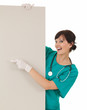 health care worker woman pointing to blank sign