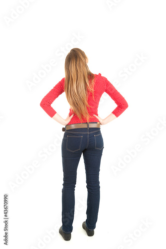 standing backwards young woman looking up, full length