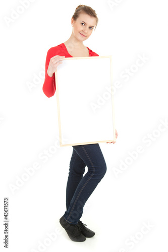 student girl presenting something on blank poster, full length
