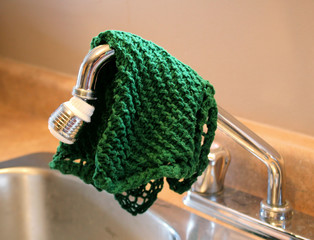 Dish Cloth Hanging Over Kitchen Sink
