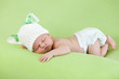 Funny sleeping newborn baby. Bunny cap on head of girl.