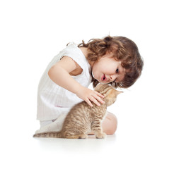 Funny child girl playing with cat kitten