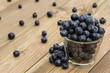 Blueberries in a glass with blurred fruits
