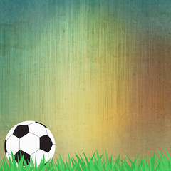 Football soccer on grass and paper background