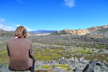 Hiking in the incredible jurassic wild landscape of green mounta