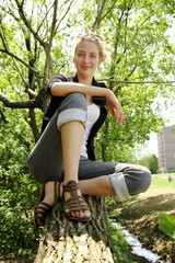 Smiling teen in a tree