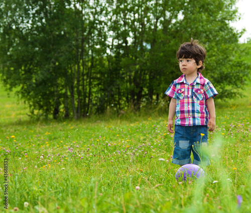 sad boy waiting friend to play from SerrNovik, Royalty-free stock