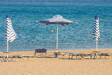 umbrellas on the beach with turquoise sea in background