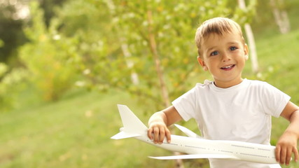 Aircraft pilot playing with toy airplane
