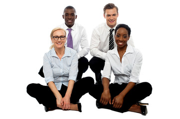 Four business colleagues sitting on floor