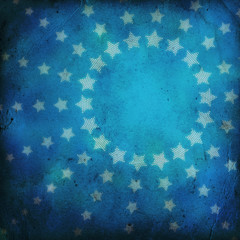 circle of stars on grunge background