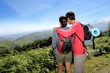 Couple on a trekking day looking at beautiful scenery