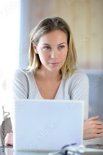 Woman sitting in front of laptop computer