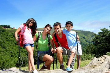 Portrait of family on a trekking day in the moutain