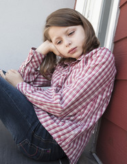 young girl thinking lonely