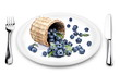 Blueberries fall of the basket on a plate.
