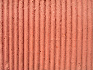 Textured orange plaster wall