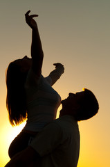 Silhouettes of young couple in love