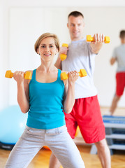 Couple working out with dumbbells