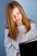 Attractive teenager girl using laptop