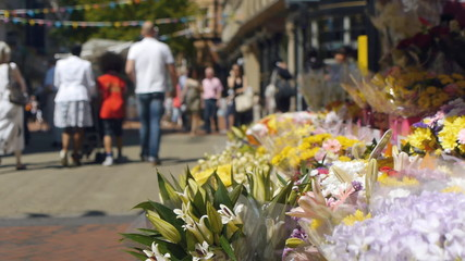 Flowers and city centre shoppers.