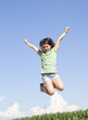 excited young girl jumping in the air