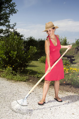 Woman raking the garden path