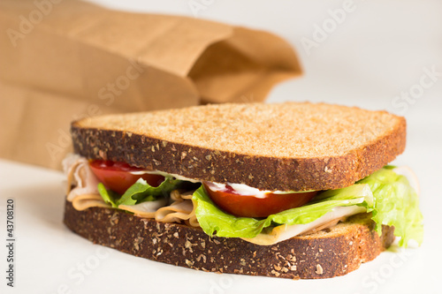 Delicious turkey sandwich  from brown bag lunch - 43708120