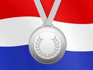 Zilver medaille met nederlandse vlag