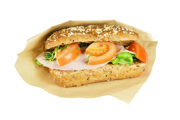 Brown sandwich with tomato, lettuce and mustard sauce.