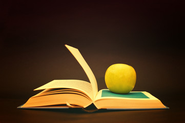 Apple on a book