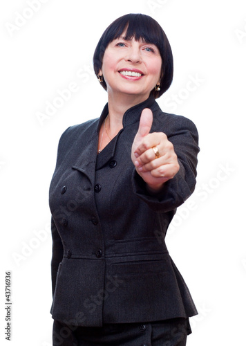 Mature business woman showing thumbs up