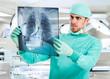 Surgeon examining a radiography