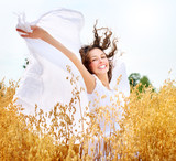 Fototapety Beautiful Happy Girl on the Wheat Field