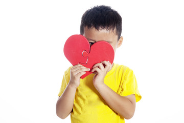 Boy with heart shaped puzzle