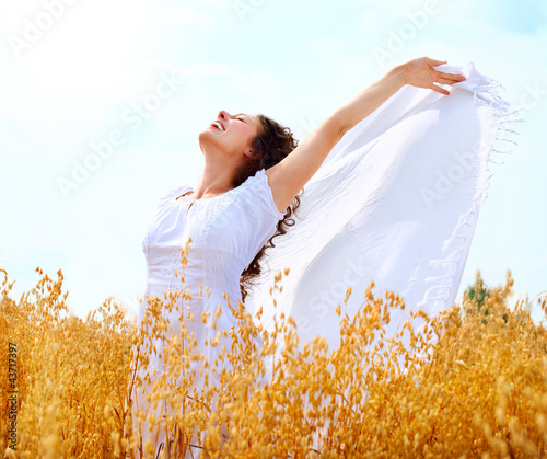 Beautiful Happy Girl Having Fun on the Wheat Field