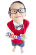Closeup of schoolboy with LEARN word