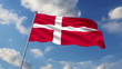 Danish flag waving against clouds background