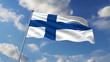 Finnish flag waving against clouds background